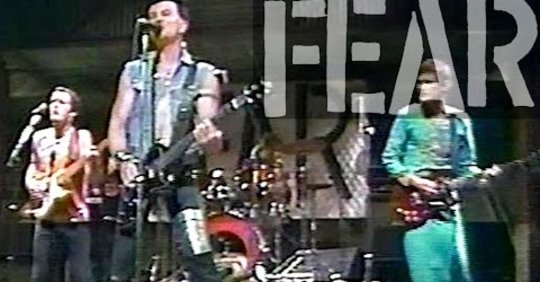 The day John Belushi invited Lee Ving's 'FEAR' to SNL and bussed in their fans was a total Punkrockracy.  Listen to Fear…